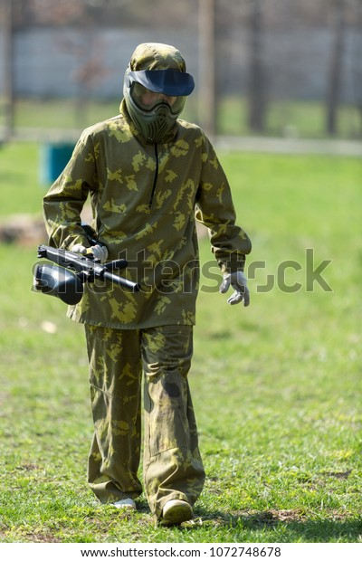 Boy Camouflage Holds Paintball Gun One Stock Photo Edit Now 1072748678