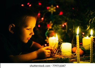 the boy with candles at Christmas