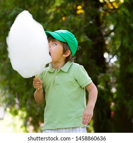 Boy with candyfloss outdoor in summer day