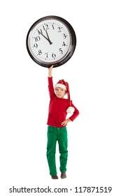 Boy in cap of Santa Claus and large clock, isolation, studio