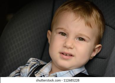 Boy in the car seat