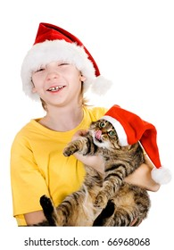 The boy and cat in caps of Santa Claus. The cat has put out language and has got to a nose.