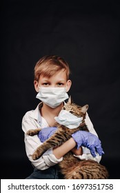 Boy and cat are in medical mask