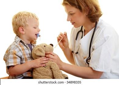 Boy checks his stuffed animal at the pediatrist