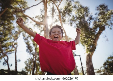 Boy cheering during obstacle course in boot camp