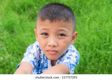 boy child begging looking up at viewer and hoping for something
