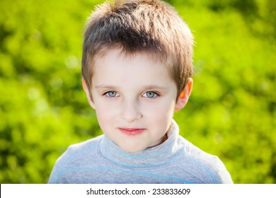 Boy child portrait on green background