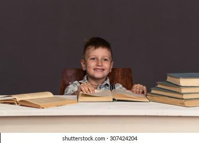 Boy Child Read Book, Children Education, Well Dressed Schoolboy on Gray background
