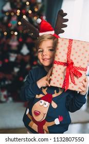 Boy with Christmas gift