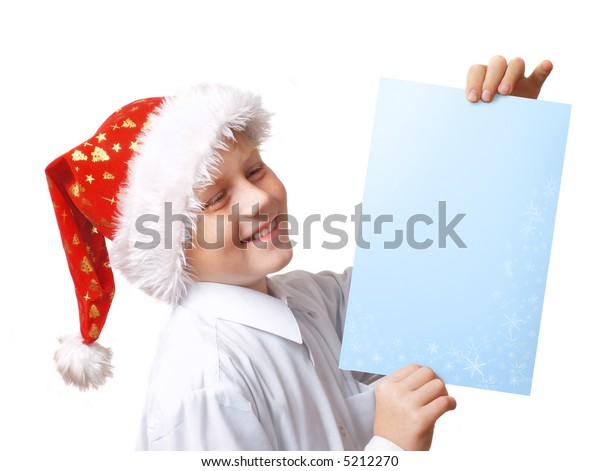 boy in christmas hat with blue paper