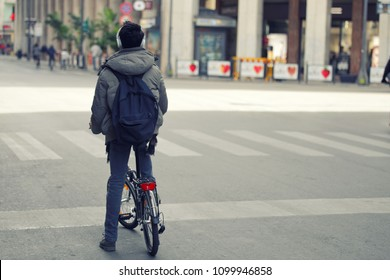 Boy in the city on a bike