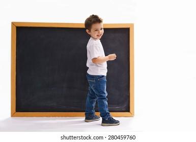 Boy in a clean chalk board