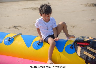 a boy climbing on banana boat
