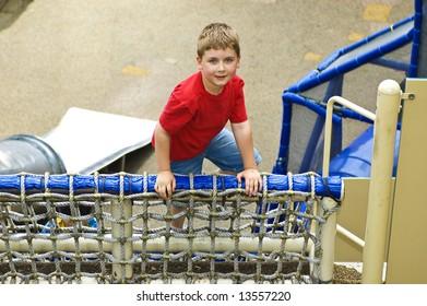 Boy Climbing on a Playground