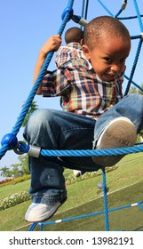 Boy Climbing Through Ropes