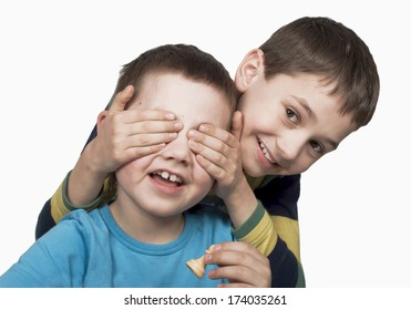 boy closes eyes to the friend on a white background