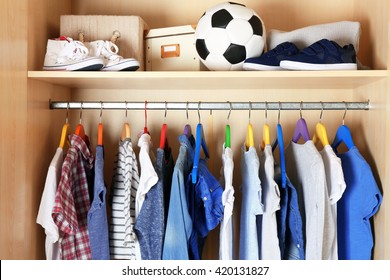 Boy clothes on hangers in the wardrobe
