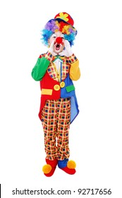 Boy clown shouting  standing over the white background