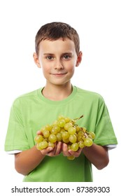 Boy with a cluster of ripe yellow grapes isolated on white background