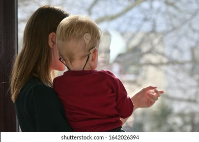A Boy With Cochlear Implants with his Mother