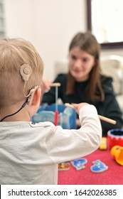 A Boy With Cochlear Implants Playing with his Mother
