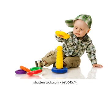 boy collecting colorful pyramid toy isolated on white
