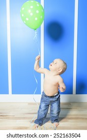 A Boy with colorful balloons in is bedroom