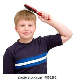 boy combs the hair on a white background
