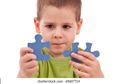 Boy connect puzzles isolated on white