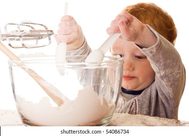 Boy cooking, mixing, and making mess. Isolated on white