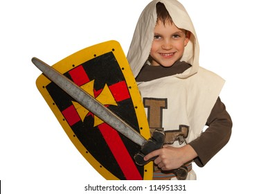 Boy in costiume of knight play and smile. White background.