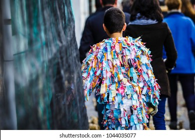 Boy costumed as Jarramplas walking to meet him at the square
