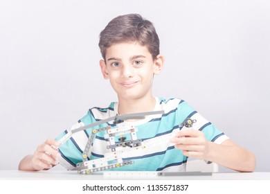 Boy creates a diy mechanical helicopter model. STEM education concept