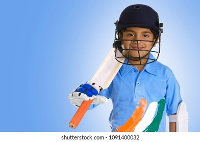 A boy in a cricketer's outfit