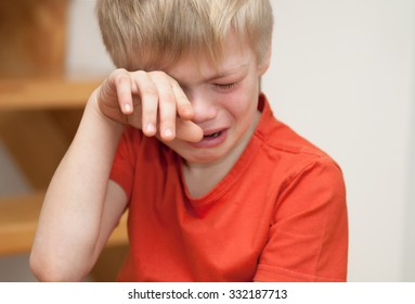 Boy cries of resentment and grief