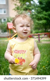 Boy crying while standing up in park