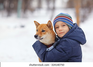 boy and a cute dog concept of friendship