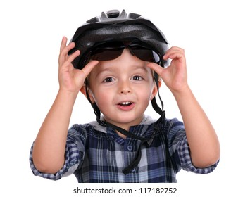 Boy with cycling helmet removing sunglasses