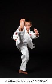 boy demonstrating traditional karate front snap kick