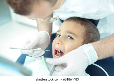 boy at dentist fxing his teeth