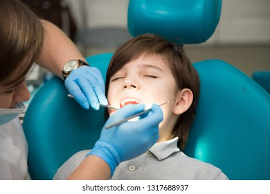 Boy at a dentist office, new teeth examination and treatment of cavities