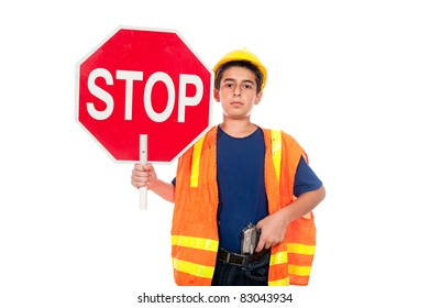 A boy directs traffic using a stop sign and a gun