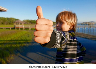 Boy displaying a thumbs-up gesture