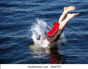 Boy diving into the sea