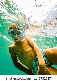 Boy diving underwater
