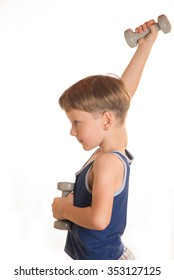 Boy does physical exercises raised the dumbbells up above the head