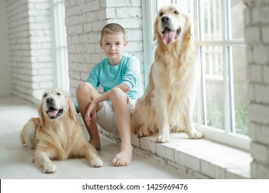 A boy with a dog at home.