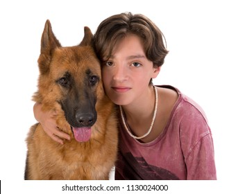 Boy and Dog portrait in studio, 11 years old boy hugs German shepherd dog isolated on white background. Looking at the camera.