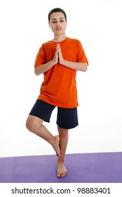 Boy Doing Yoga Pose in a Studio