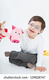 Boy with Down Syndrome playing with puppets